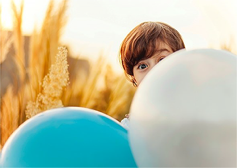 Photo of boy with balloons